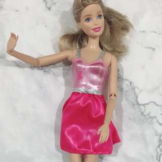 Barbie with pink dress and braids