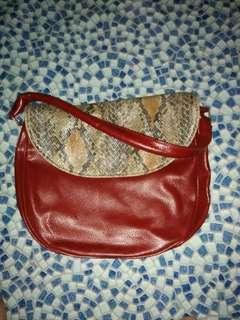 Avon maroon shoulder bag