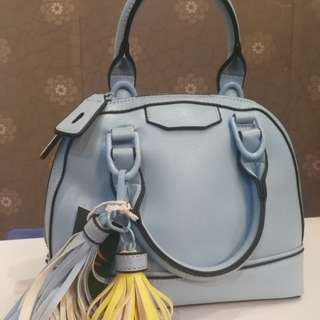 Soft blue hand bag with sling