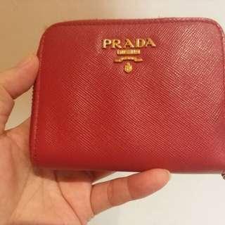 Red coins bag of Prada