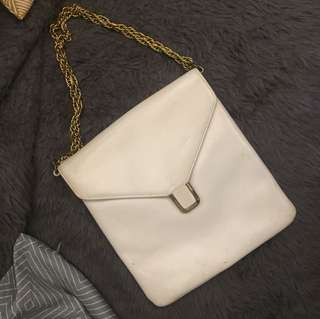 White sling bag with gold chain