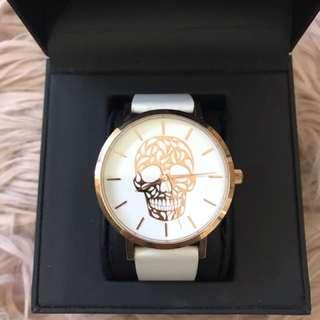 Rose gold skull watch