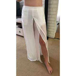 White satin feel pants with slit. Brand new size 8