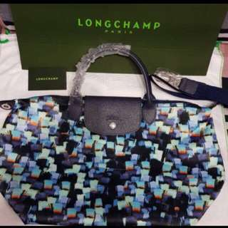 Authentic longchamp vibrant medium for sure buyer only so no wasting time pls...
