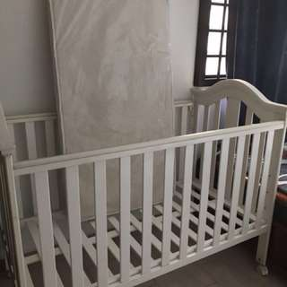 White baby cot with mattress