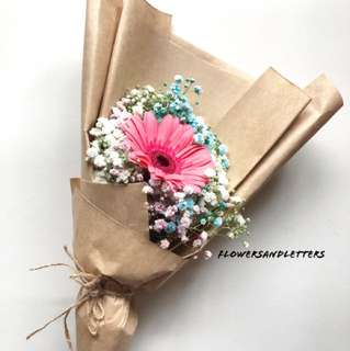 [VDAY PREORDER] Pink gerbera daisy wraps with mixed colourf blue, pink and white baby's breath bouquet in brown kraft wrapping paper