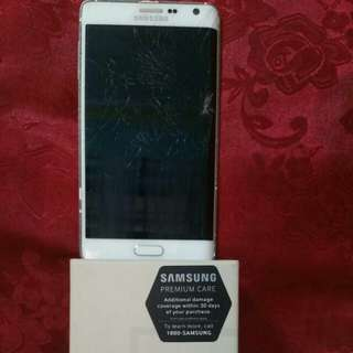 FAULTY WHITE SAMSUNG GALAXY NOTE EDGE N915G WITH ITS UNUSED ACCESSORIES