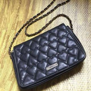 Moschino leather sling bag with flaws