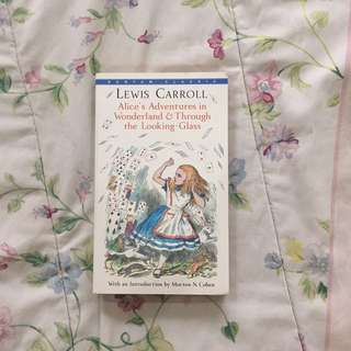 Alice's Adventures in Wonderland & Through the Looking Glass' by Lewis Carrol
