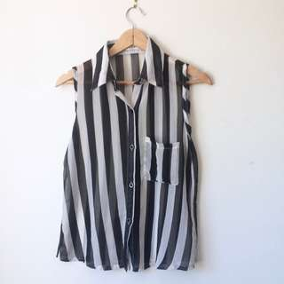 Striped black and white sleeveless blouse