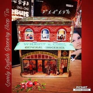 Beautiful Collectable English Grovery Shop Biscuit Tin with a Roof (that can open or close) in front.  $10 offer! sms 96337309.