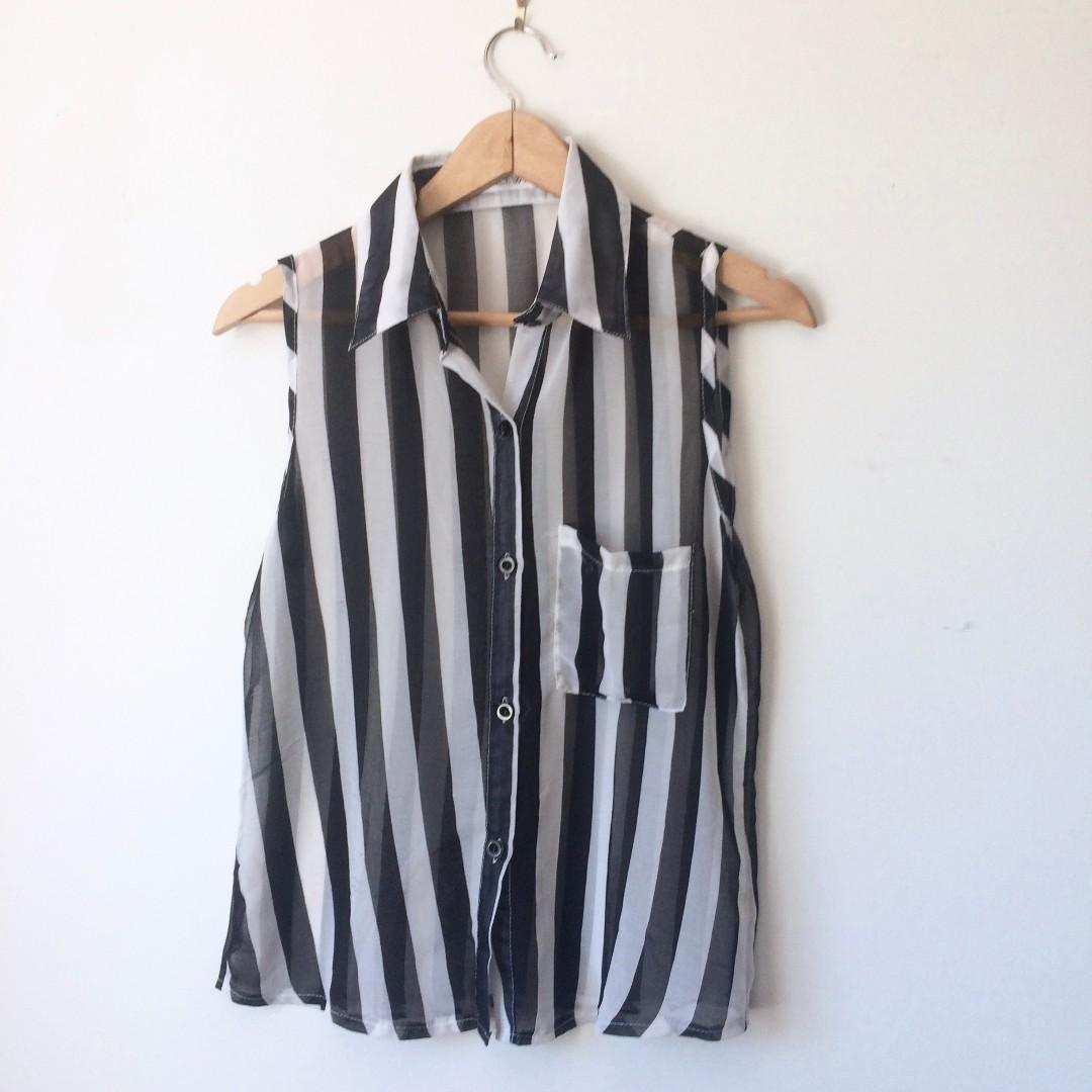 Striped black and white sleeveless blouse
