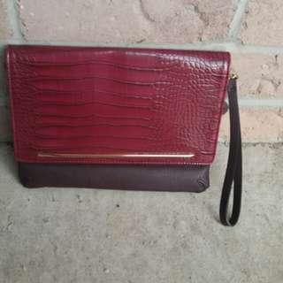 Beautiful 2 tone burgundy cluth from Aldo