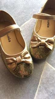 Girls sparkly gold shoes