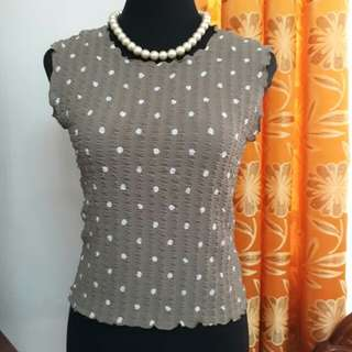 Brown sleeveless blouse