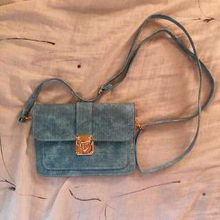 Sky blue acid wash small sling bag