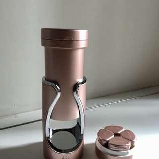Tic travel bottle