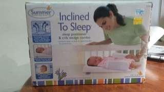 Newborn sleep positioner