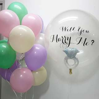 Ring in Giant balloon with Pastel Helium Balloons