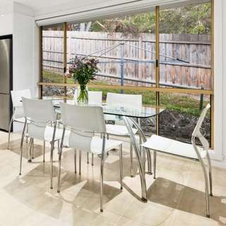Modern glass dining table with 6 chairs