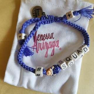 Vanessa Arizaga purple bracelet