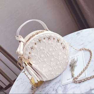 Floral embroidery round sling bag