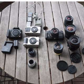 Lot of Canon, Olympus, Panasonic, Carl Zeiss, Sigma, C-mount, lens and mirrorless bodies, working and for parts