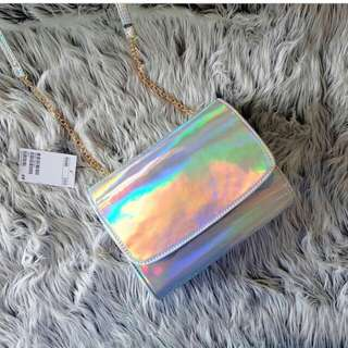 hnm clutch hologram