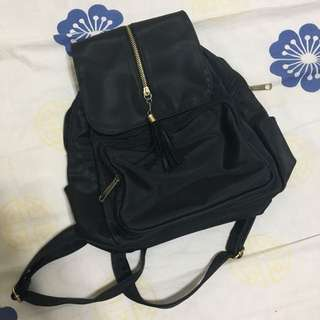 Black with gold details backpack