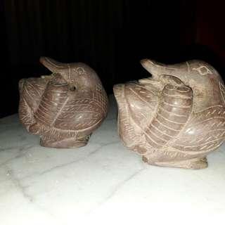 pair of carved vintage ducks