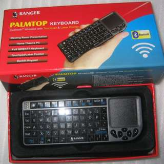 Bluetooth Keyboard with Touchpad . small Palm-size