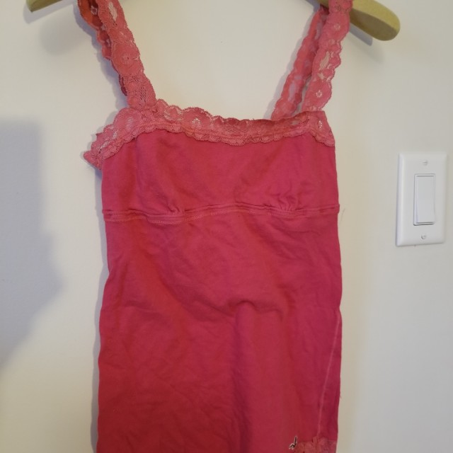 Hollister lace tank top. Size XS. Practically new. Pick up Yorkville or Beaches. Yes its available. Ad will be removed once sold. Message with preferred location and pickup date and time. Priced to sell.