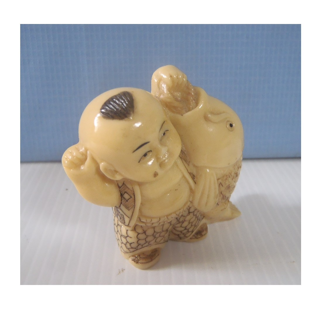 Vintage hand carved Japanese netsuke /'boy with fish late 1900s cast resin unused
