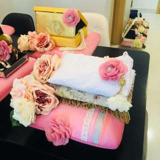 telekung gift set on dusty pink striped tray with pink Camille flower brooch