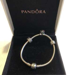 Pandora Silver bracelet with 1 charm and 3 stoppers!