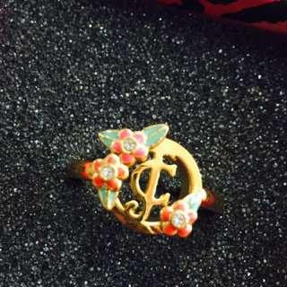 J C logo ring