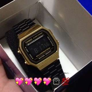 Black and gold casio