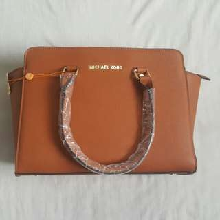 Mk Hand and Sling Bag
