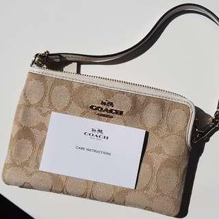 Brand new Coach wristlet purse wallet