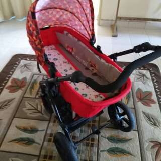 Stroller and baby sit