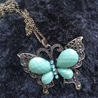 Long necklace w/ butterfly pendant