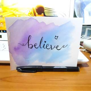 Watercolour background with calligraphy writing - believe