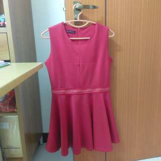 Red sleeveless dress with zip detail at waist