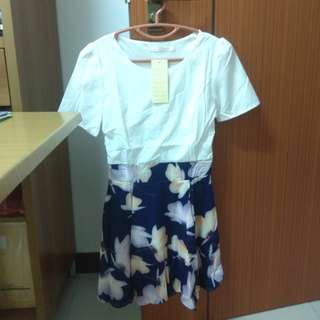 White short sleeved dress with floral skirt