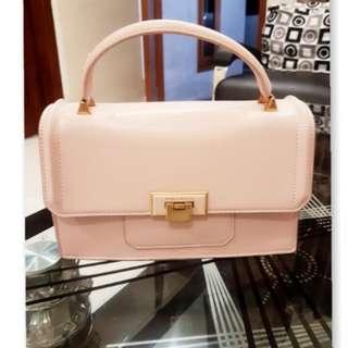 Charles and keith pink sling bag