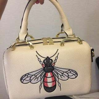 Beige hand bag with sling from HK