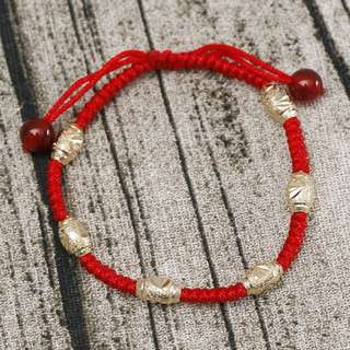 Red strings bracelet with gold plated spacers