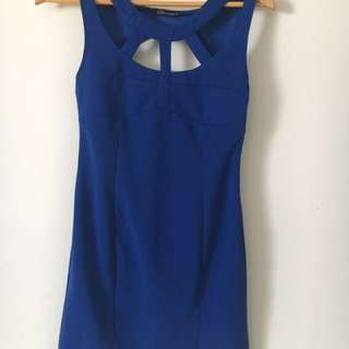Women's blue mini body con dress with front cut outs and open back