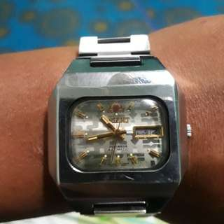 Orient watches. Optional English or Arabic day.. Made in Japan. No battery. Automatic movement.