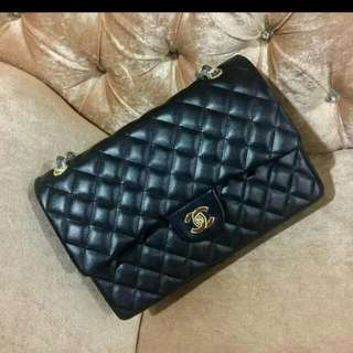 Chanel maxi black lamb skin
